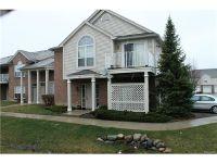 Home for sale: 30211 Chesapeake Cir. #355, Walled Lake, MI 48390